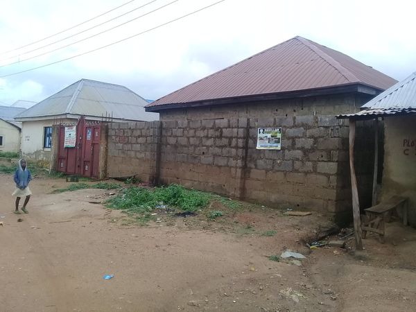 QUICK SALE:A Carcass 3 Bedroom Bungalow fully roofed and well secured with fence wall and a security gate on a plot measuring 50ft by 50ft.
